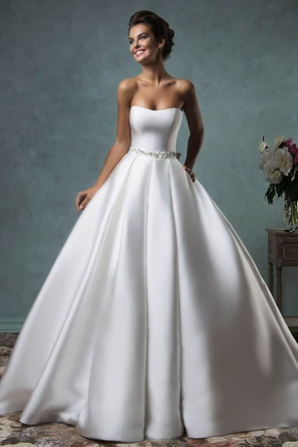 Floor Length White Satin Ball Gown Wedding Dress Simple Design With Strapless Neckline On The Bodice It Comes A Court Train When Pleated Skirt Fall